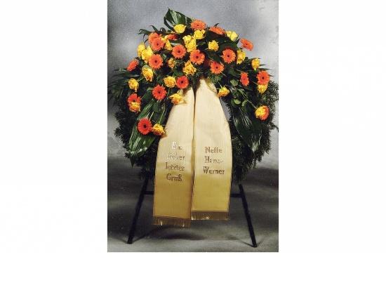 Kranz mit orange Gerbera u. gelben Rosen