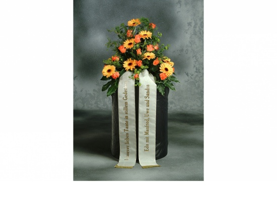 Gebinde mit gelben Gerbera u. orange Rosen