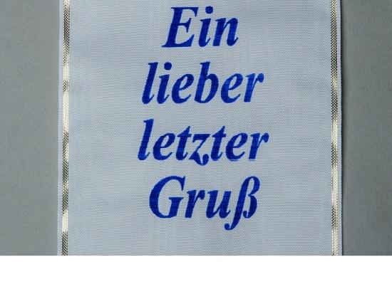 Kranzschleife mit blauer Schriftfarbe